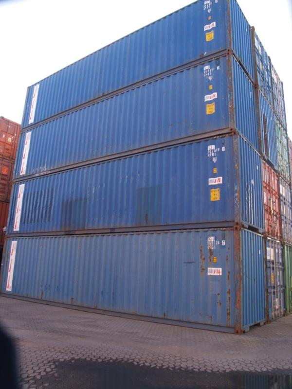 A stack of used 40' hi-cube containers